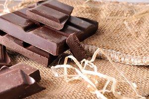 Heap portions chocolate on burlap