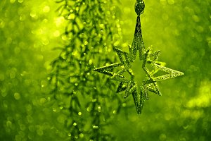 Shiny silver star and green lights