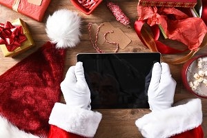 Santa Claus With Tablet Computer