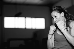 Professional female athlete boxing