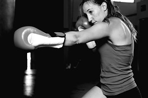 Side view of female boxer practicing