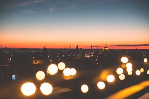 Sunset Cityscape with Bokeh Lights