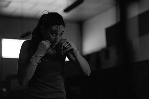 Professional female boxer practicing