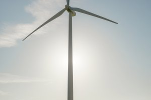 Wind turbine over a blue sky