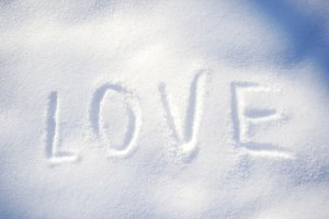 Writing text LOVE on the snow