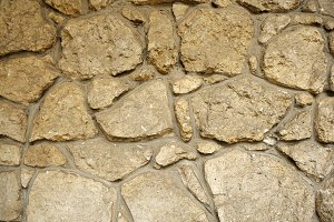 Close-up stone wall texture.
