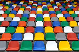 Plastic colorful chairs stands on st
