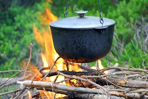 Cooking in the nature. Cauldron on f