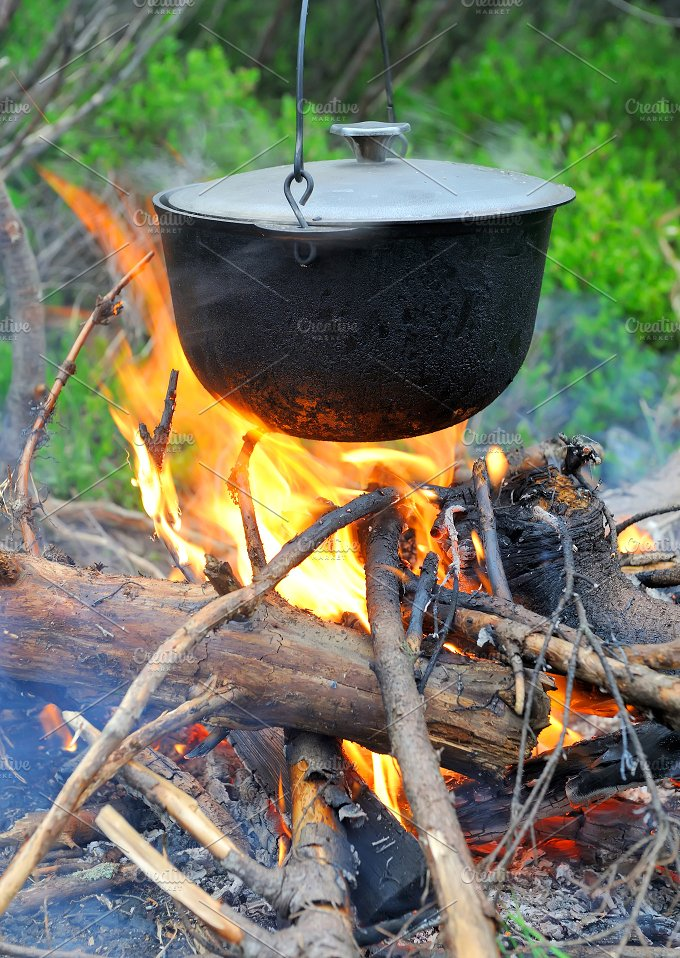 Cooking in the nature. Cauldron on f - Food & Drink