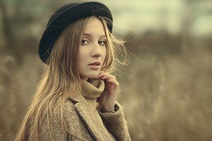 Beautiful fashionable woman in a hat