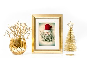 Golden frame and Christmas ornaments