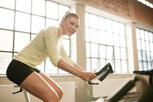 Sportive woman working out on exerci