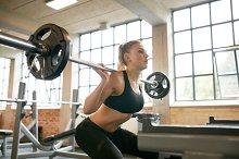 Female exercising in gym doing squat