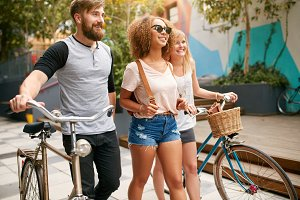 Three friends with bikes having fun