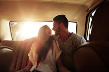 Happy young couple on road trip