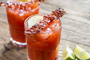 Glasses of Bloody Mary with bacon