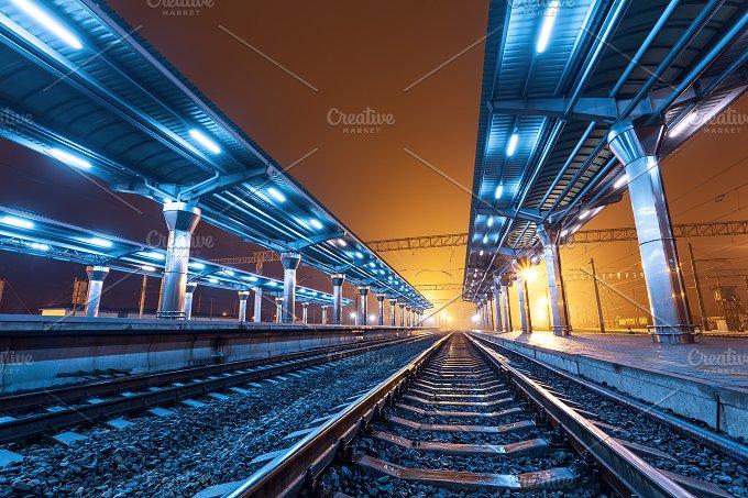 Railway station at night. Railroad - Transportation
