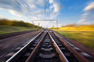 Railroad at sunset with motion blur