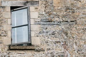 Cotswolds stone wall and window