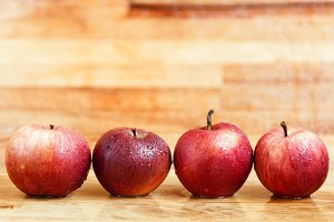 Fresh apples on wooden background