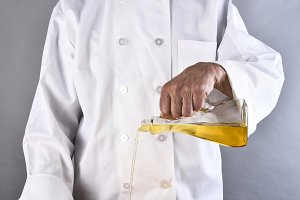 Chef Pouring Oil