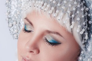 closeup portrait of a snow maiden on gray background