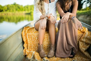 Two Female Models Outdoors In Boat