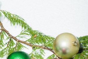 Christmas balls on cedar