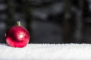 Red ornament in snow