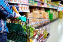 Man pushing shopping cart in the supermarket aisle.jpg