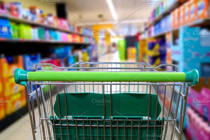 Shopping cart in the supermarket aisle rear view.jpg - Food & Drink