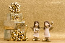 Little angels with gift boxes