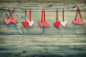 Red hearts hanging on wooden