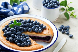 Blueberry pie in enamel baking dish
