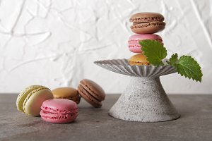 macarons on a gray background with m