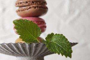 macarons in gray vintage vase with m