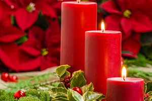 Red candles with poinsettias