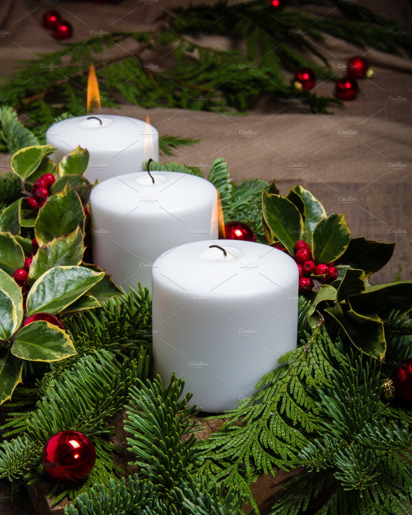 Evergreen centerpiece with candles holiday photos