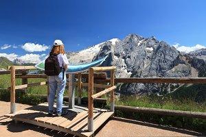 hiker looks Mt Marmolada