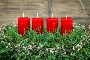 Advent three red burning candles