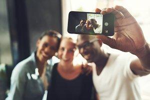 Multi ethnic friends taking a selfie