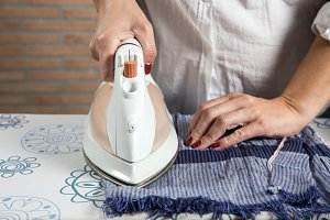 Middle-aged woman ironing