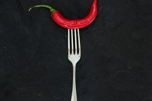 Red hot chili pepper! on silver fork