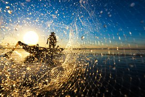 Fisherman action with water splash
