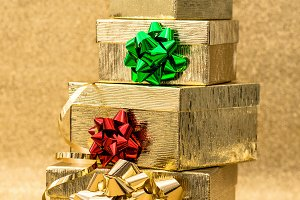 Golden gift boxes with ribbon bow
