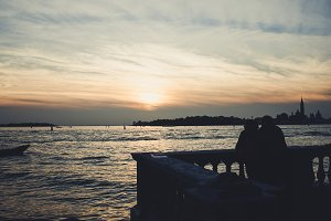Couple viwing the sunset in Venice