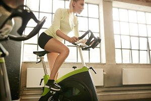 Woman working out on gym bike