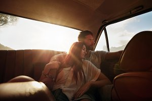 Relaxed young couple in a car