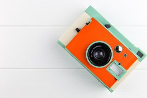 Orange camera on white background