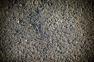 Grey earth and gravel macro texture